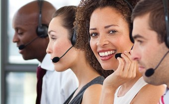 Smiling young businesswoman working in a call center