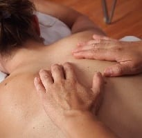 photo of person getting a relaxing massage