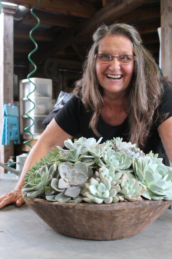 Sharon Smith in front of a lovely succulent arranged made with her CoCo2 product