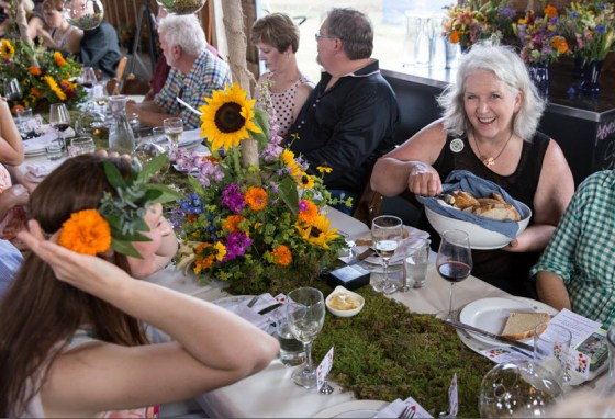Debra Prinzing, the mother of the Slow Flowers movement, enjoys the great local flowers, the great local food and the company of many passionate flower lovers at the recent American Grown Field to Vase Dinner in Blanco. Photo credit: Whitney Devin for Field to Vase Dinner Tour.
