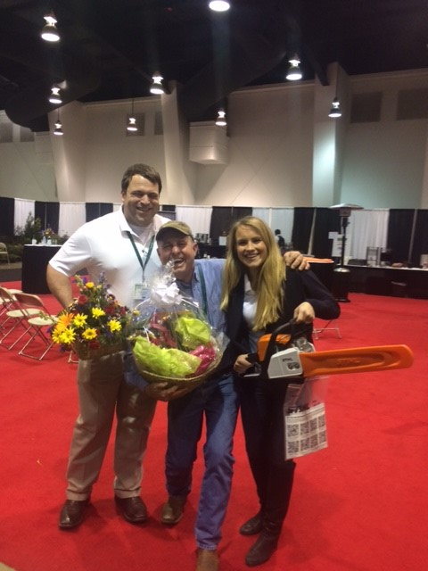 Jonathan Saperstein, CEO of Tree Town Enjoys time with his co-workers at an industry trade show