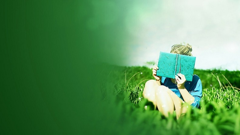 Girl reading a book on the grass wallpaper 1280x720