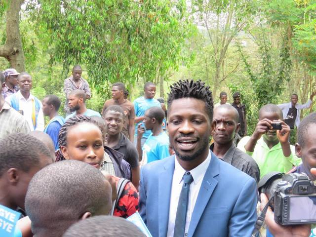 Bobi and Barbie at Besigye's Kasangati home during the opposition leader's press conference.