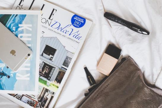 cosmetics bag, magazines and iPhone