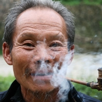 Old village man smoking
