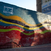 Black shadow against colourful wall, Shiraz