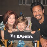 "Maxim with Amy Price-Francis and Benjamin Bratt on the set of ""The Cleaner"""