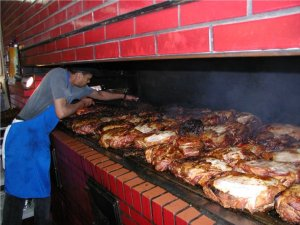 Meat being cooked at the Original Golden Rule BBQ