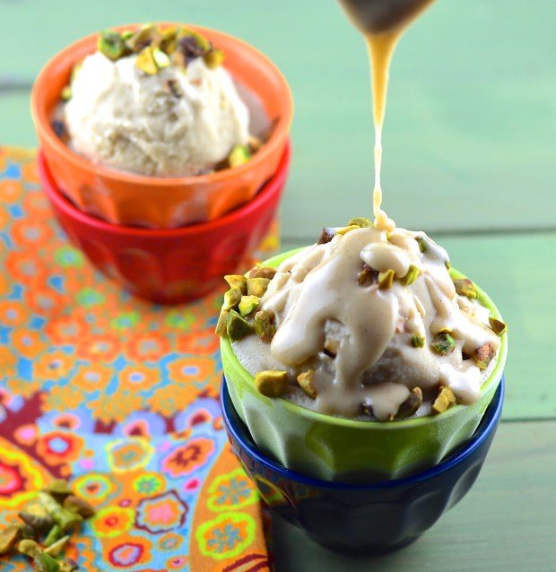 Vegan tahini icecream with sweet halvah sauce and crunchy pistachios