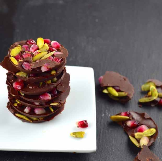 The perfect little after dinner treat luscious dark chocolate, crunchy pumpkin seeds and fresh pomegranate seeds. Pretty and festive. #thanksgiving #Rosh Hashanah #Hanukah #chanukah #Holidays