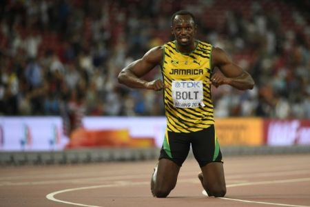 802421 le jamaicain usain bolt celebre son re de champion du monde du 200 m a pekin le 27 aout 2015 ?modified at=1440687616&width=750