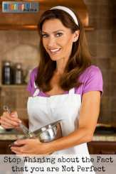An attractive smiling woman, a typical American Mom, mixing and baking in her kitchen