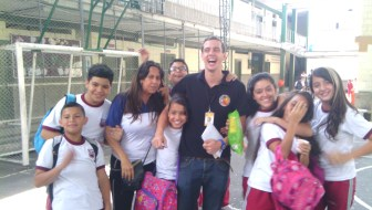 A volunteer with students at Marina Orth Foundation