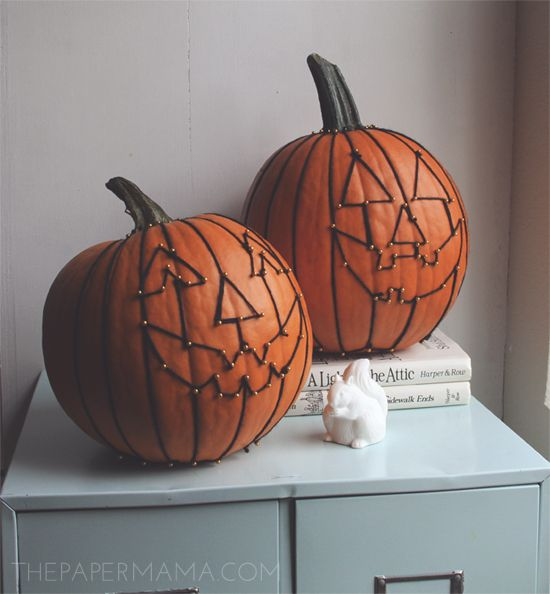 Decorate your pumpkin with pins and yarn.