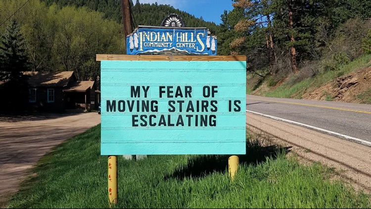 The story behind that punny sign in Indian Hills   9news com What started as an April Fool s Prank has turned into a community favorite  for those passing