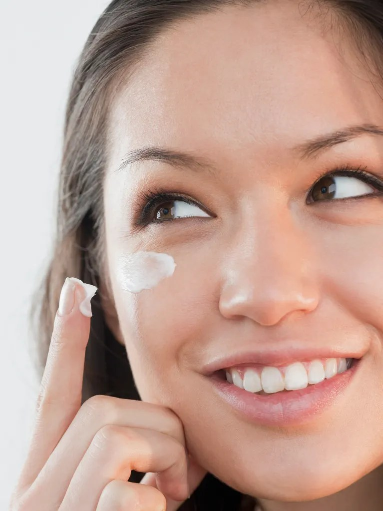 Woman Applying Cream Under Her Eyes