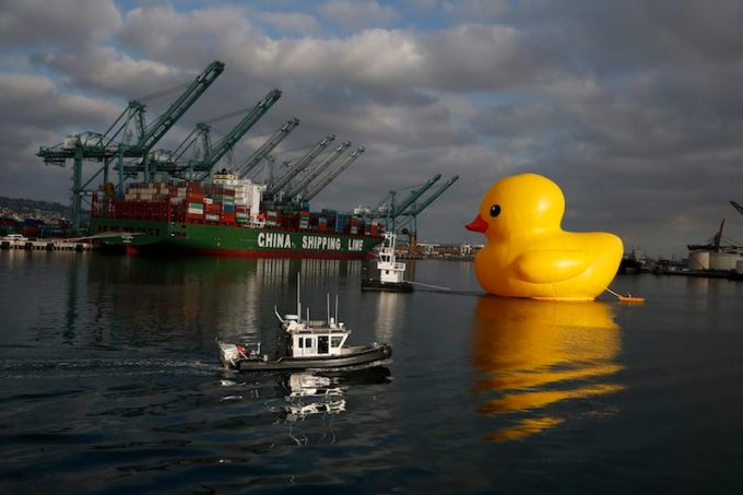 Giant inflatable rubber duck installation by Dutch artist Florentijn Hofman floats through the Port of Los Angeles as part of the Tall Ships Festival, in San Pedro