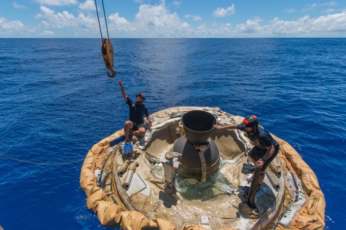 Divers retrieve the test vehicle for NASA's Low-Density Supersonic Decelerator off the coast of the U.S. Navy's Pacific Missile Range Facility in Kauai, Hawaii. Image: NASA/JPL-Caltech