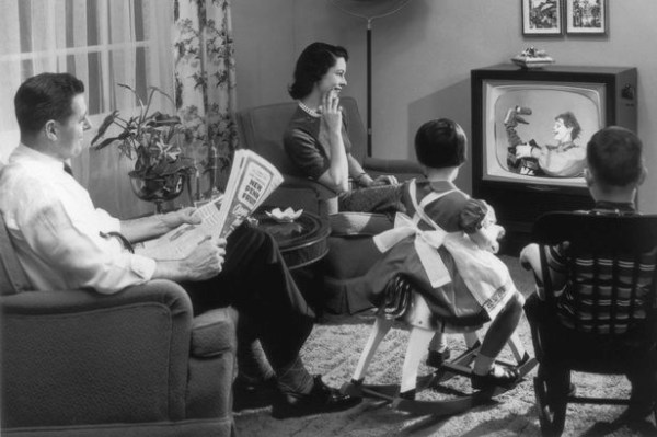 A-family-sits-in-their-living-room-watching-a-childrens-television-programme