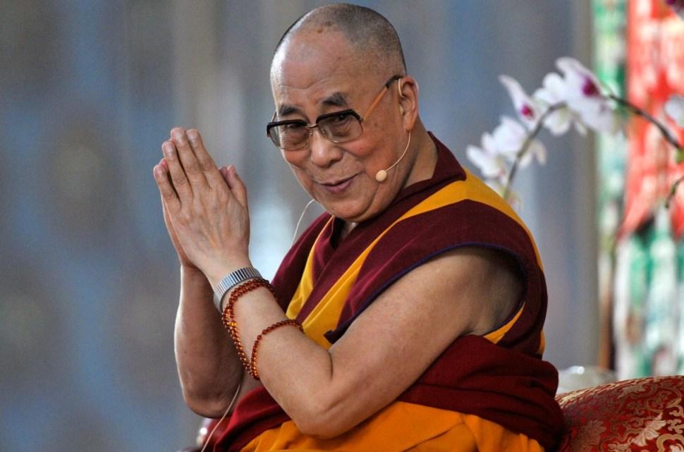 The Dalai Lama speaks to his followers at the Gaden Jangtse Thoesam Norling Monastery in Mundgod, 2014. REUTERS