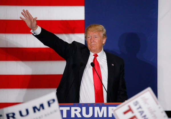 Donald Trump waves during a campaign rally in Cedar Rapids, Iowa Feb. 1, 2016. REUTERS
