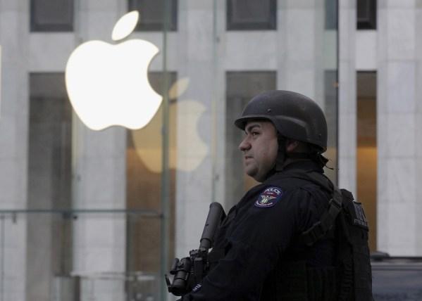 NYPD officer across the street from Apple's 5th Ave. store, NYC, March 11, 2016. REUTERS