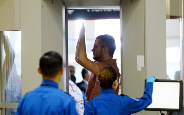 An airline passenger stands in a full-body scanner at an LAX TSA checkpoint in 2014. (Reuters)
