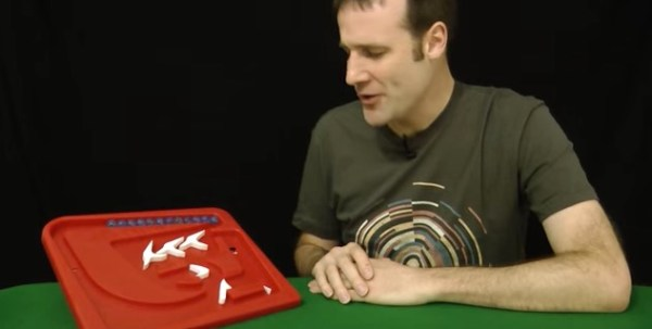 """Video about a cool gravity-fed marble """"computer"""" game that beats human players"""
