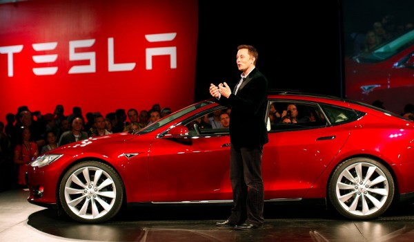 Elon Musk, CEO of Tesla, with a Model S. Reuters
