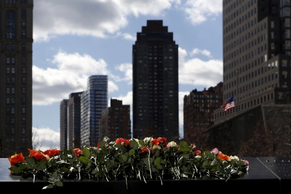 Flowers on the reflecting pool of the 911 Memorial, February 26, 2016. REUTERS