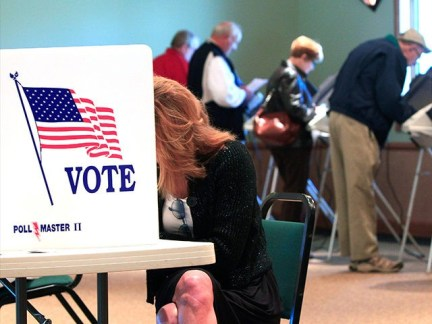 A steady stream of voters fill the voting booths at Ronald Reagan Lodge, Tuesday, Nov. 6, 2012, in West Chester, Ohio. (AP Photo/Al Behrman)