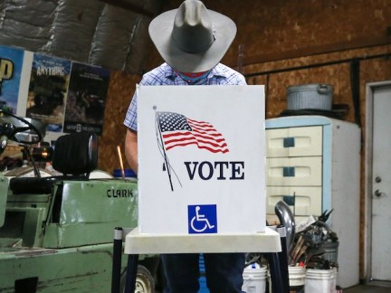 A voter marks his ballot at a polling place in Dennis Wilkening's shed on November 3, 2020 in Richland, Iowa. (Mario Tama/Getty Images)