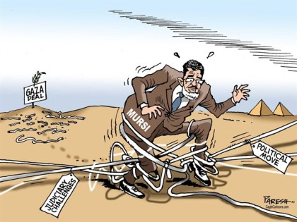 Paresh Nath - The Khaleej Times, UAE - Mursi in trouble COLOR - English - Mursi, Egypt, President, judiciary challenges, decree, political move,tangle,Gaza deal,Arab spring