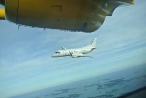 Saab 340 i formation med MU2