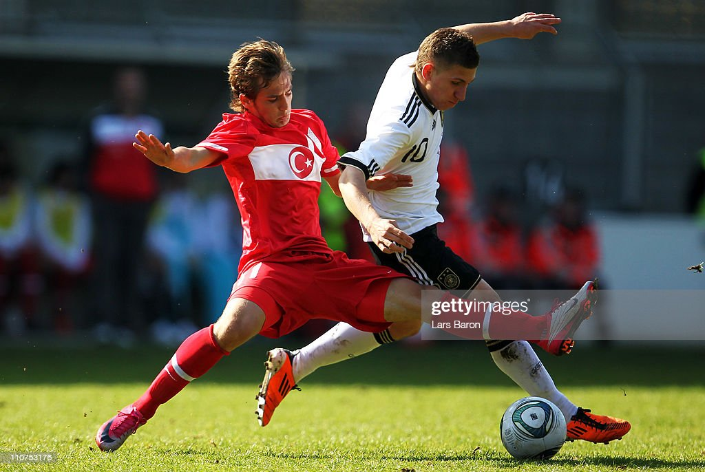 U17 Germany v U17 Turkey   UEFA European Championship Elite Round     Mehmet Erkut Senturk of Turkey challenges Levent Aycicek of Germany during  the UEFA U17 European Championship