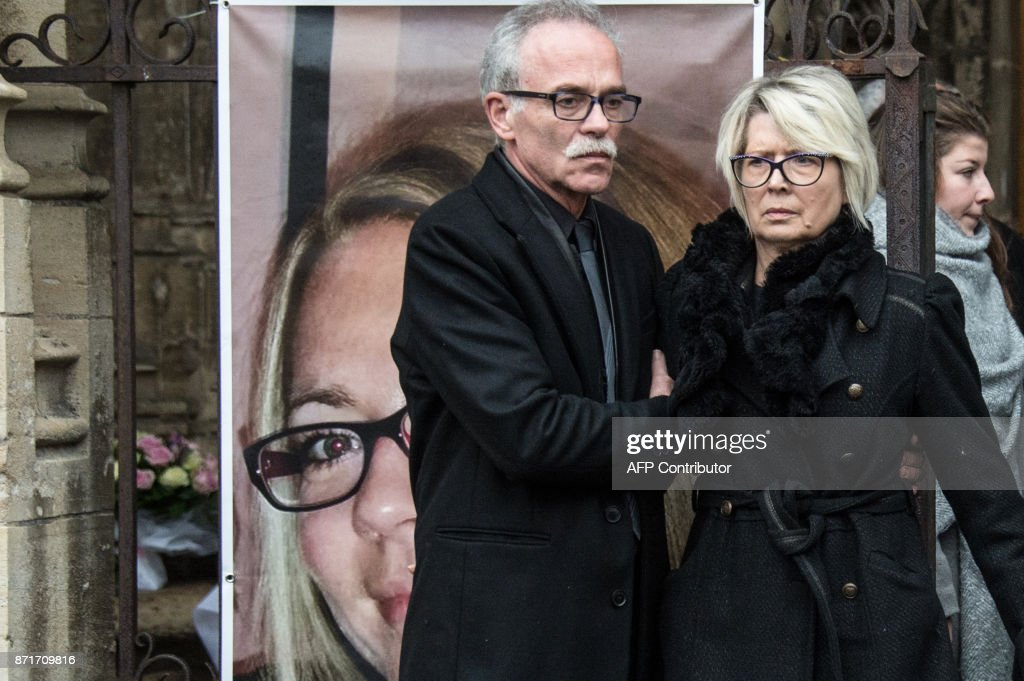 Parents of Alexia Daval  her father Jean Pierre Fouillot  L  and her     Parents of Alexia Daval  her father Jean Pierre Fouillot  L  and her mother  Isabelle Fouillot  look at the coffin of Alexia Daval  a young jogger found
