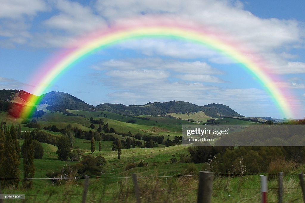 Rainbow Stock Photos and Pictures   Getty Images Rainbow above the valley  New Zealand