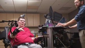 Man with quadriplegia uses thought-controlled technology to move again