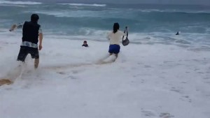 Boy nearly swept out to sea as daring rescue in Hawaii caught on camera