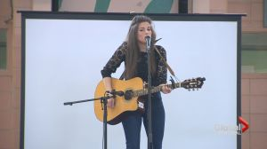Brittany Kennell sings St. Thomas High School