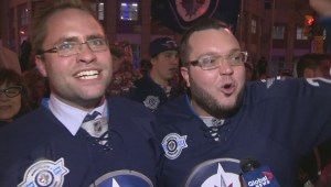 Winnipeg Jets fans celebrate at Portage Avenue and Main Street