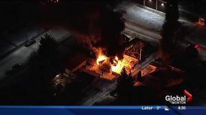 Edmonton garage destroyed, home damaged in fire