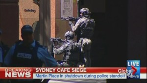 Two gunman take hostages at Australian cafe