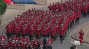 Sea of red: marching RCMP officers enter funeral