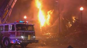 Burning building collapses, killing 2 firefighters in Kansas City