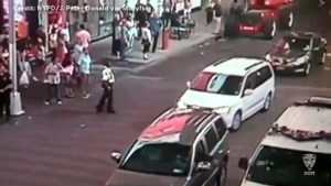 CCTV video captures man throwing suspicious package into NYPD patrol car