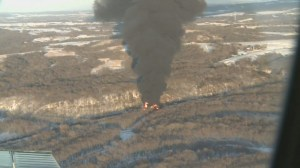 RAW:  Illinois train derailment sends think crude oil smoke into air