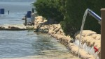 Flood protection barriers being built up as water levels in central Okanagan keep rising