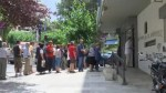 Timelapse shot of people queuing for cash