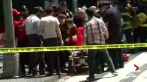 Victim put on stretcher after car strikes pedestrians in Times Square